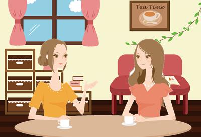 喫茶店で会話する女性たち