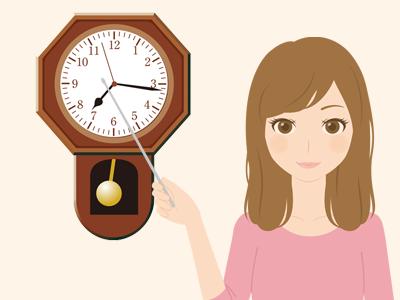 時計を指す女性